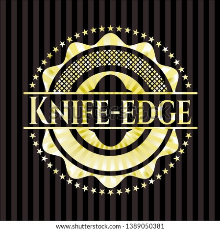 knife edge gold badge or emblem
