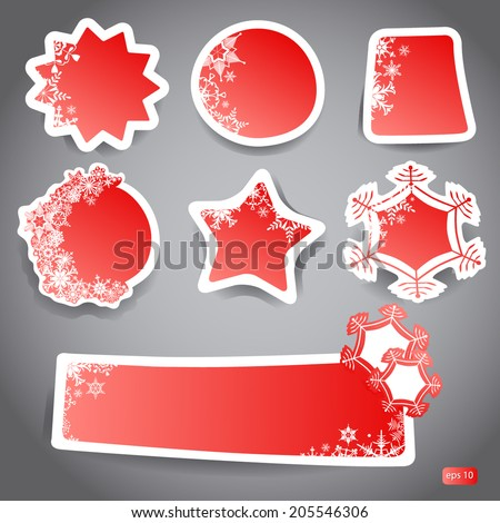labels for winter discounts with snowflakes in red color