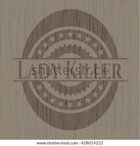 Lady Killer badge with wood background