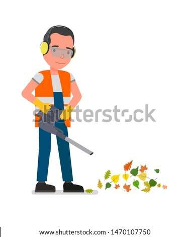 Landscaper operating petrol Leaf Blower in the city park. Worker on a street in autumn collects leaves with a leaf blower.