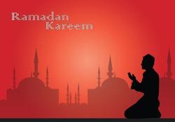 Lanterns for Ramadan wishing, Muslim feast of the holy month of Ramadan Kareem. Translation from Arabic: Generous Ramadan, silhouette of muslim man during pray