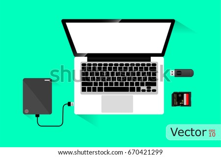Laptop and Hard disk storage, Vector design on green background.