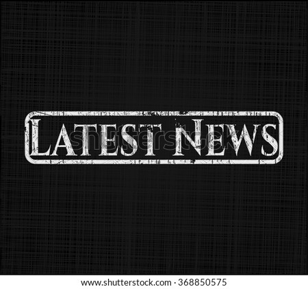 Latest News chalkboard emblem on black board