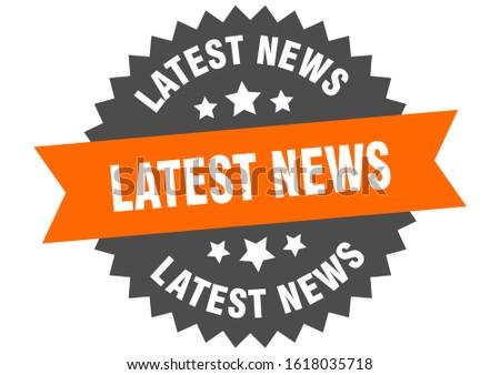 latest news sign. latest news orange-black circular band label