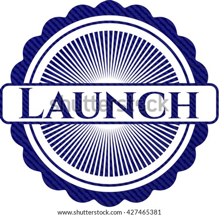 Launch badge with denim texture