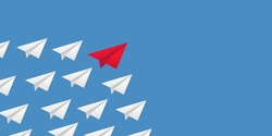 Leadership success concept paper plane fly over blue background. New idea, courage, new thinking, creative decision, think differently. Lead airplane stand out of other paper plane followers