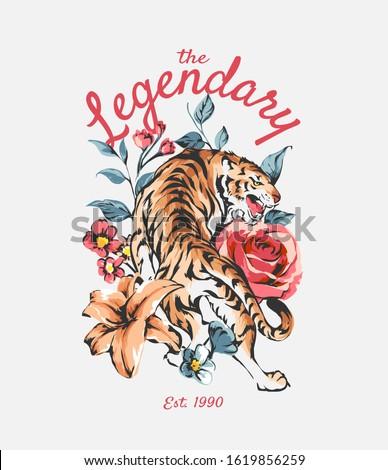legendary slogan with tiger on wild flowers illustration background Zdjęcia stock ©