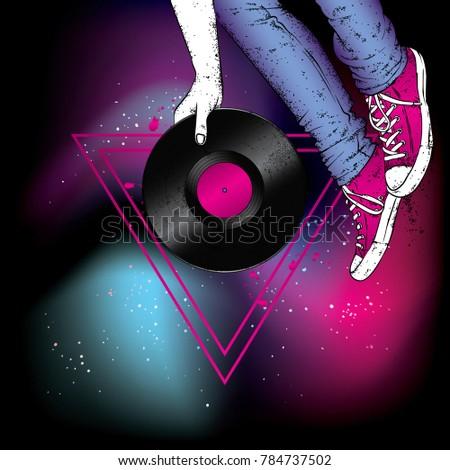 legs in sneakers and a vinyl
