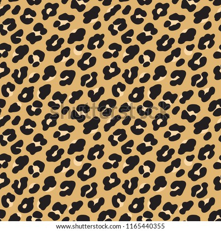 Leopard print. Brown black fur seamless pattern. Vector illustration background.