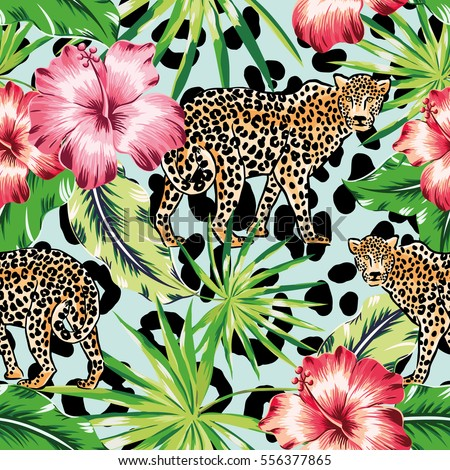 leopards with palm leaves and