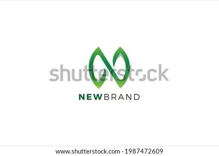 Letter N green color natural leaf modern environmental business logo Foto stock ©