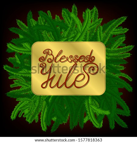 lettering blessed yule, decorated with green pine-tree branches
