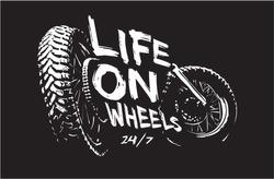 life on wheels slogan with bike wheels illustration