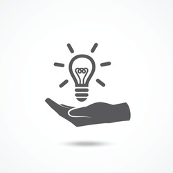 Light bulb in hand icon