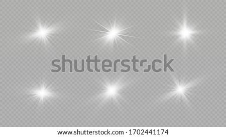 Light effect. Bright Star. Light explodes on a transparent background. Bright sun.