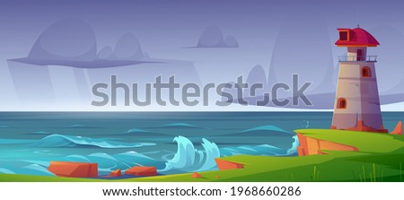 lighthouse on sea shore at