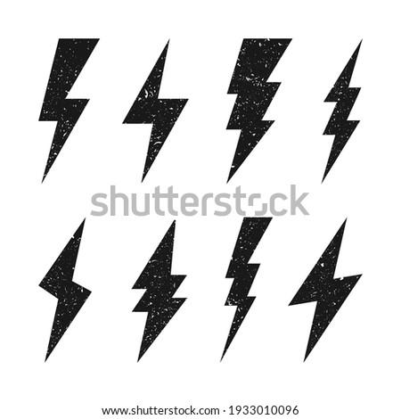Lightning bolt icons with grunge texture isolated on white background. Vintage flash symbol, thunderbolt. Simple lightning strike sign. Vector illustration.