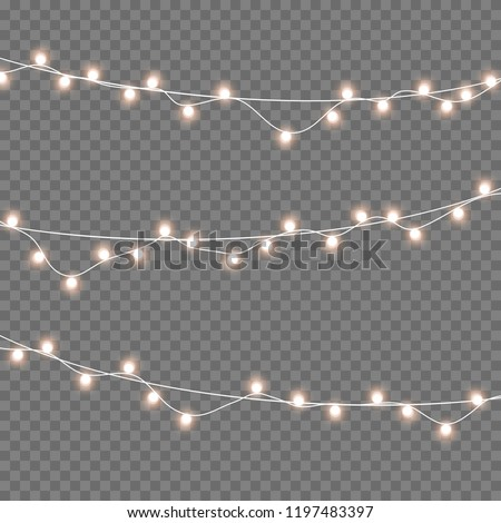 Lights bulbs isolated on transparent background. Glowing golden Christmas garlands string. Vector New Year party lights decorations.