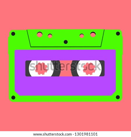 lime stereo compact cassette on a pink background