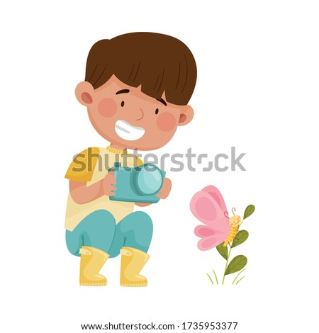 Little Boy Hunkering Down with Camera Taking Photo of Butterfly Sitting on Grass Vector Illustration Stockfoto ©