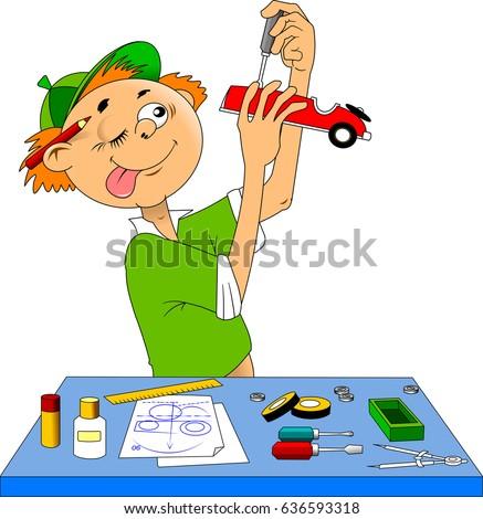little boy makes a model of a