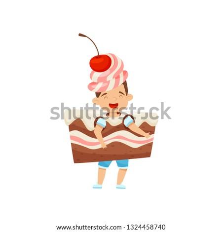 little boy wearing cake slice