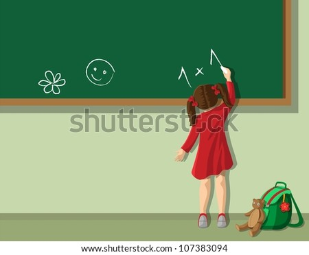 Little girl writing on blackboard in  the classroom