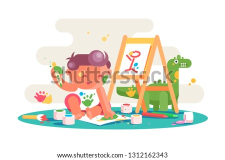 little kid painting picture on