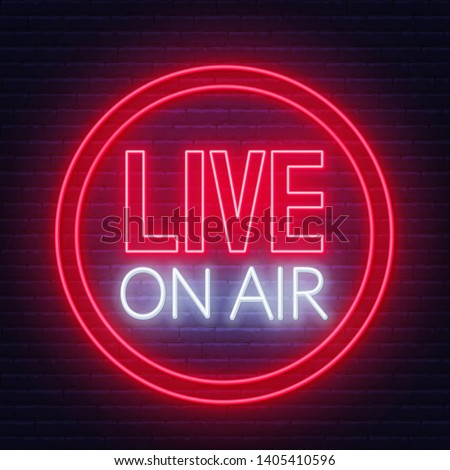 Live on air glowing neon sign on brick wall background. ストックフォト ©