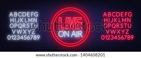 Live on air glowing sign on brick wall background. Template for design. Neon alphabet . ストックフォト ©