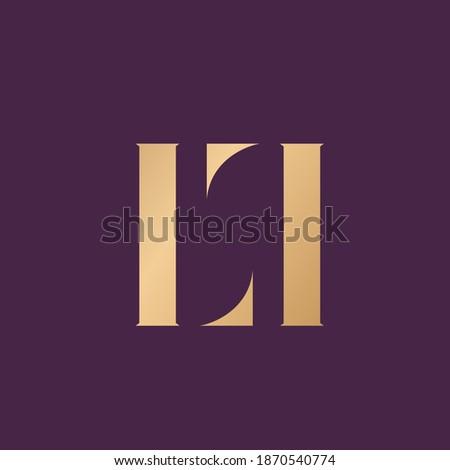 LL monogram logo.Decorative lettering sign.Metallic gold alphabet initials icon isolated on dark fund.Elegant, beauty, luxury style characters shape.Typographic uppercase serif letter l. Stock fotó ©