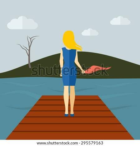lonely girl standing on a lake