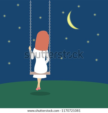 lonely woman sitting on a swing