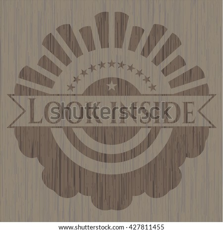 Look inside badge with wooden background