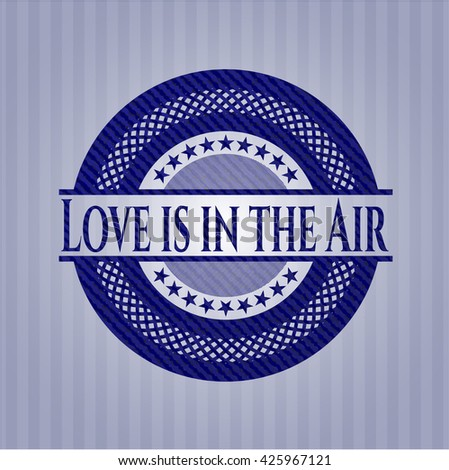 Love is in the Air badge with denim background