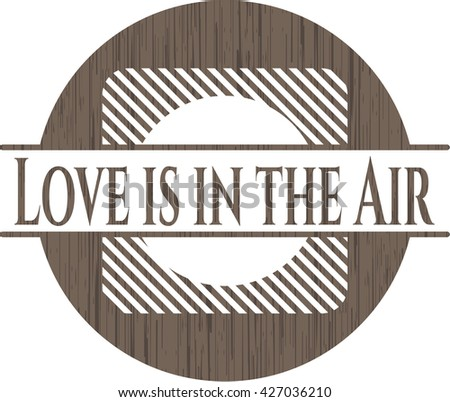 Love is in the Air badge with wood background
