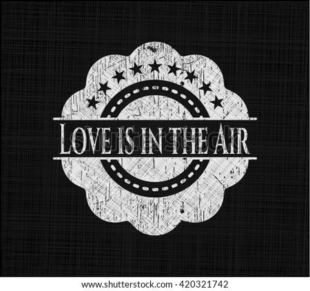 Love is in the Air chalkboard emblem written on a blackboard