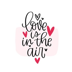Love is in the air Valentines day greeting card vector design with traditional quote. Pink and black two colours calligraphy with romantic saying.