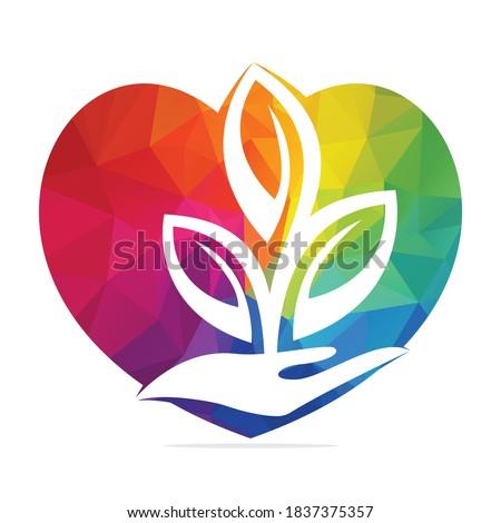 love plant in hand vector logo