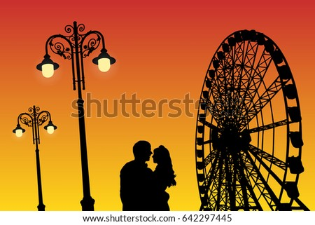 lovers in amusement park at