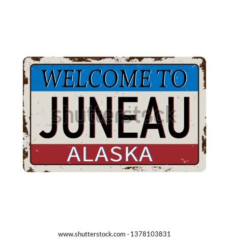 Luneau Alaska vintage rusty metal sign on a white background, vector illustration