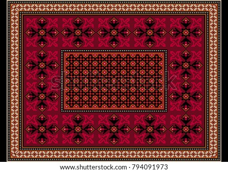 Luxurious burgundy carpet with ethnic ornaments with patterns of crimson flowers on the border and orange brown frame the edges