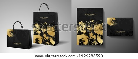 Luxury shopping paper bag design. Template with gold and black print. Luxe abstract blot (brush stroke) pattern for brand gift packet, premium shop purchase. Vector modern layout Stockfoto ©
