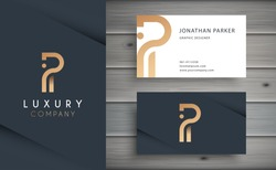 Luxury vector logotype with business card template. Premium letter P logo with golden design. Elegant corporate identity.