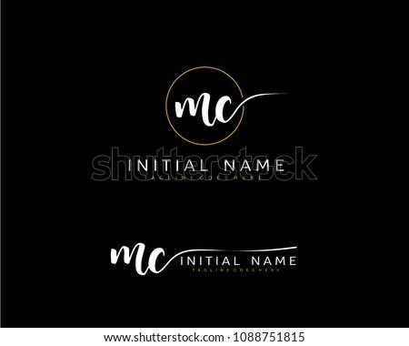 M C Initial handwriting logo vector. Hand lettering for designs. Zdjęcia stock ©