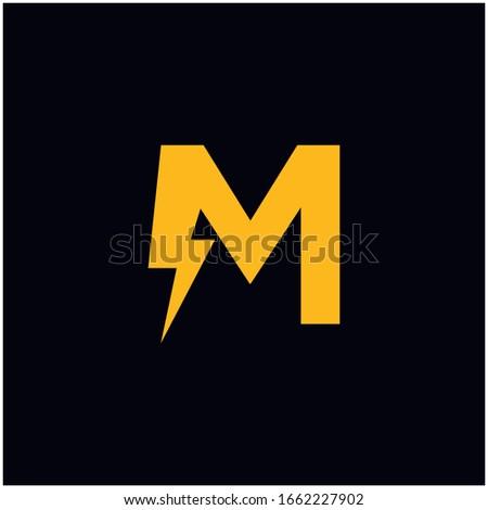 M Letter Logo Design With Lighting Thunder Bolt. Electric Bolt Letter Logo Vector Illustration. Stock fotó ©