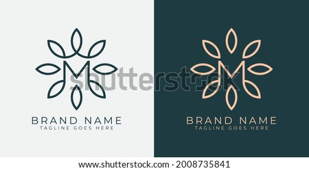 M Letter with Flower logo. Vector logo template Сток-фото ©