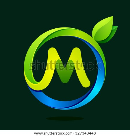 m letter with green leaves and