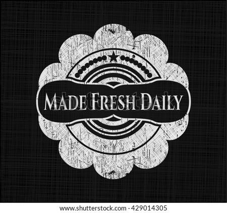 Made Fresh Daily chalk emblem written on a blackboard