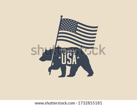 Made in USA label badge or logo design with bear holding american flag silhouette isolated on light  background. Vintage styled vector illustration. Foto stock ©